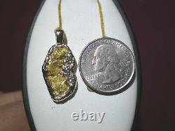 Natural gold nugget pendant and. 30 ct in diamonds